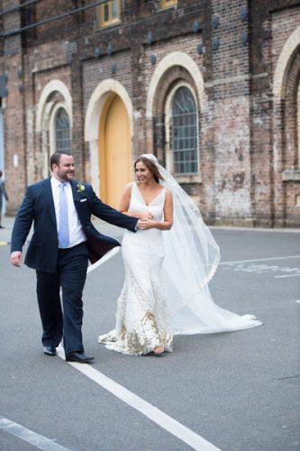Bride and Groom walking down road