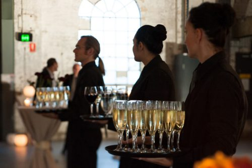 Forte Catering staff holding wine glasses